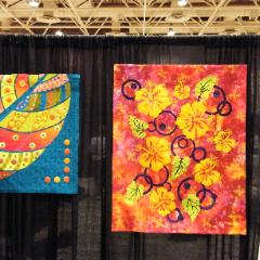 Quilts hung with invisible NoSeeUms� hangers for exhibit booths
